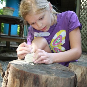 Girl Playing with the Tumblehome Dino Excavation kit