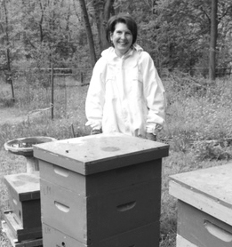 Robbie Shell with beehives