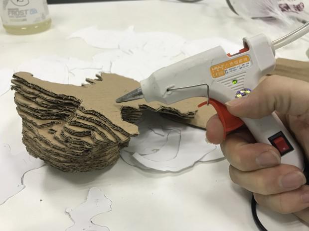 Glue gun hominid skull cardboard
